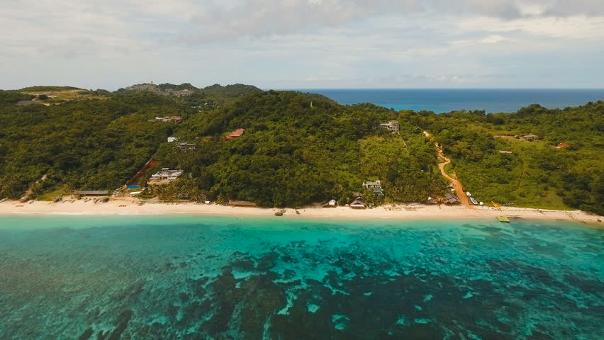 Aerial View Of Beautiful Tropical Island With White Sand Beach Hotels And Tourists