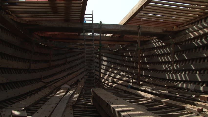 UAE - CIRCA 2008: Pan-right shot of inside a boat under construction. Wooden skeleton of the boat. The maritime industry remains a key factor in the Emirates economy.