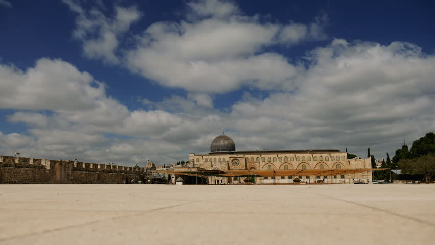 Al-Aqsa Mosque in Jerusalem on the top of the Temple Mount timelapse. Al Aqsa mosque is a sacred place for all muslims and islamic people.