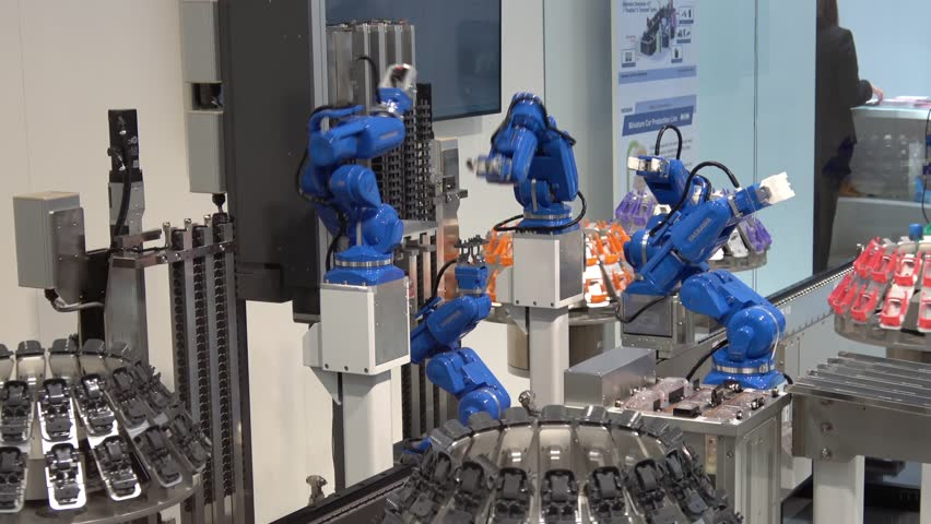 Hannover, Germany - March, 2017: Yaskawa industrial robot hands in manufacturing industry on exhibition Cebit 2017 in Hannover Messe, Germany