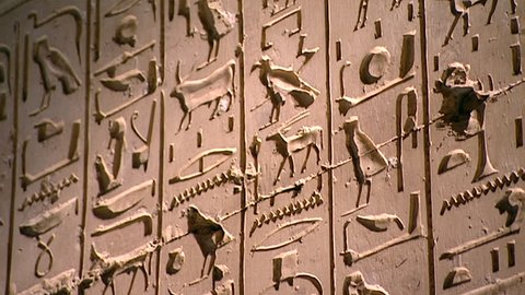 ABYDOS, EGYPT - CIRCA 2002: Low-angle view of carved heiroglyphs from the 19th Dynasty Temple of Abydos. Abydos is considered one of the most important archaeological sites in Egypt.