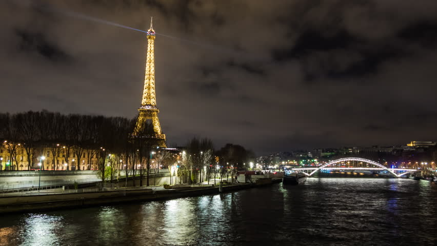 PARIS, FRANCE - JANUARY 2017: night illuminated paris city seine river eiffel tower riverside panorama 4k time lapse circa december 2017 paris, france. | Shutterstock HD Video #27395503