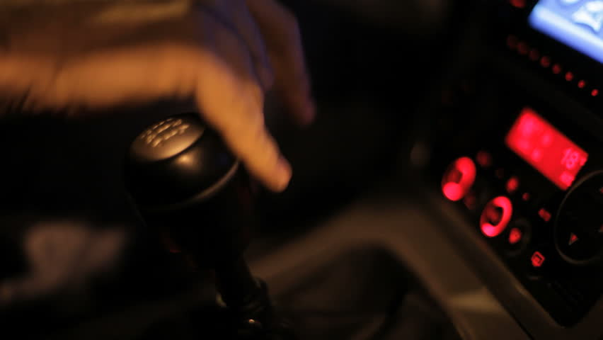 Driver man controls auto and switch gears. Close up of gear shift in car. Gearbox auto of manual transmission. Car dashboard panel. Change gear in car