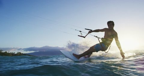 Young man kite surfing. Extreme kite boarding in slow motion. Summer fun action sports. Happiness in nature. Shot on RED