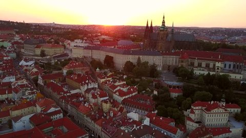 Beautiful aerial sunset view of the Prague city from above. Amazing city landscape footage. Castle of Prague on the horizon