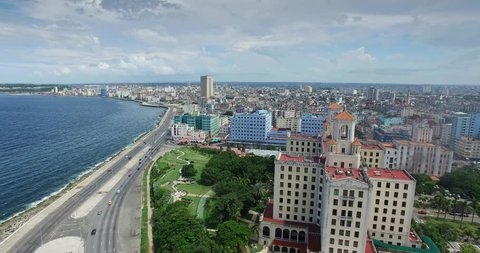 Drone flying over Havana, Cuba: Hotel Nacional and Malecon promenade. Aerial view of La Habana, Cuban capital city. Urban landscape seen from the sky with old buildings, homes, houses, Caribbean sea