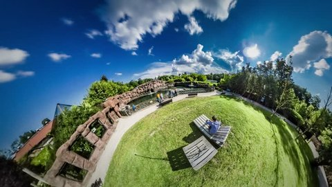 360Vr Video 360 Degrees, Timelapse. Family Vacations in Warm Summer. Recreation at the Nature, Green Fresh Lawns. Father and Little Kid on a Chaise Longue Are Looking Around at Visitors of the Zoo.