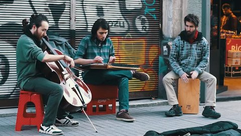 ISTANBUL, TURKEY, JUNE 5, 2017: Street musicians performing at one of the corners of Beyoglu Avenue, one of the most famous avenues in Istanbul, visited by nearly 3 million people in a day.