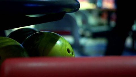 Multicolor bowling balls in bowling club slow motion. Close up bowling balls for bowling game