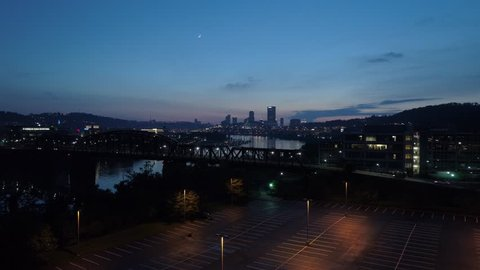 Southside Works Pittsburgh Hot Metal Bridge 4K Aerial with Illuminated Pittsburgh Skyline at Night