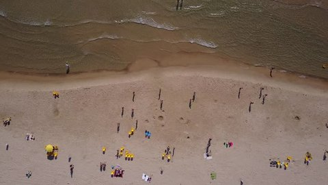 top down aerial view of people having fun at the beach