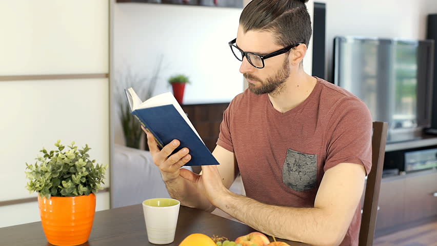 Handsome man finish reading book and going somewhere, steadycam shot  | Shutterstock HD Video #27551833