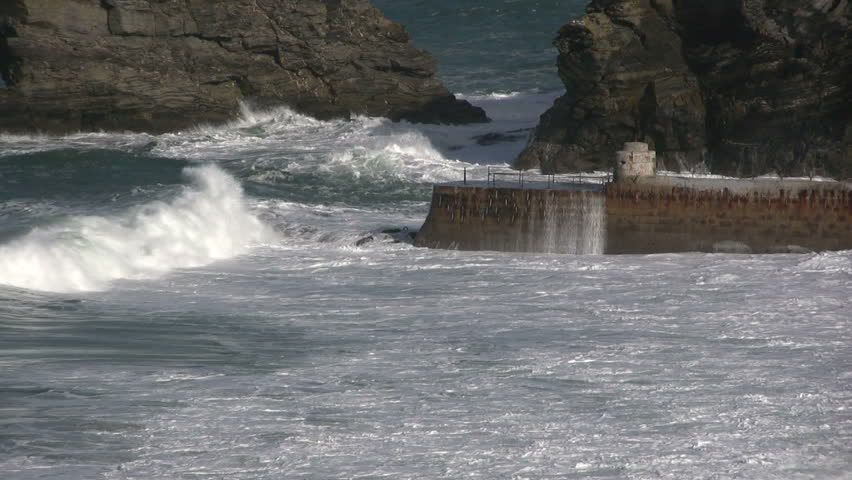 Waves crashing against Portreath pier, Cornwall UK. | Shutterstock HD Video #275893