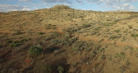 Aerial drone video view of B1 highway south of capital Windhoek and railway line in African savanna landscape in dry season in central highland Khomas Hochland of Namibia, southern Africa