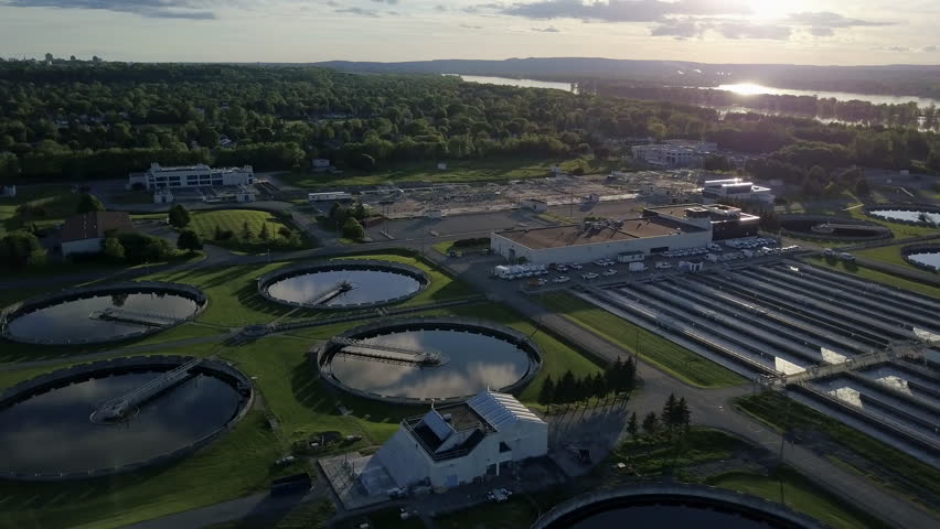 Aerial of a city's waste management sewage and water treatment plants
