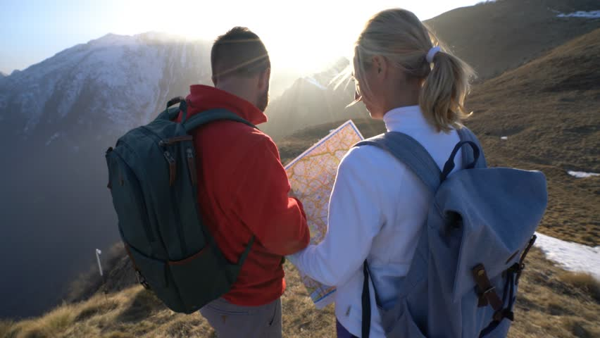 4k00:12Teammates hiking in Switzerland looking at map Hikers ... on