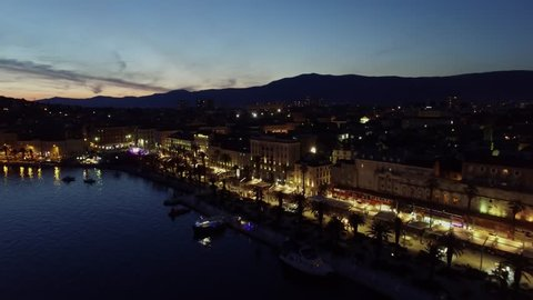 Cityscape with lot of tourists get rest on embankment of Split city in Croatia. Aerial view