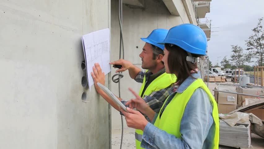 Indian electrical engineer doing works at construction for How to read construction site plans
