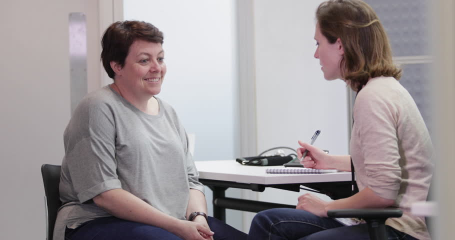 Overweight patient happy to be feeling better | Shutterstock HD Video #27704323