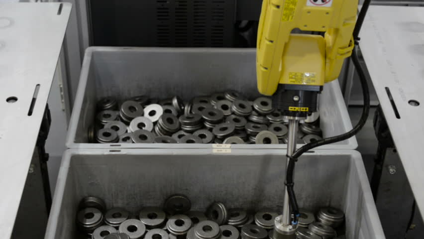 The robot manipulator produces sorting of metal objects. Demonstration of the possibilities of machine vision. Vertical panning | Shutterstock HD Video #27720961