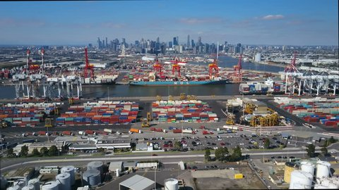 Melbourne, Australia - Apr 12, 2017: 4k aerial video of the Port of Melbourne container terminal and city center
