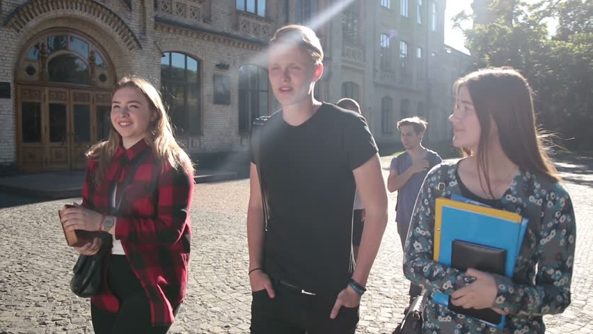 Joyful group of students going to college outdoors | Shutterstock HD Video #27745150