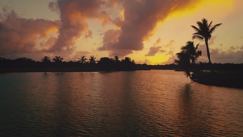 Sunset near golf course lake in luxury resort. Punta Cana, Dominican Republic