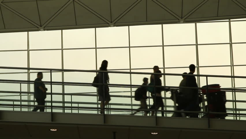 Silhouettes of Travellers in Airport - Hong Kong International Airport Terminal. | Shutterstock HD Video #2776679