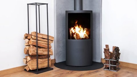 Seamless loop - fire in modern wood stove near wood racks, HD video