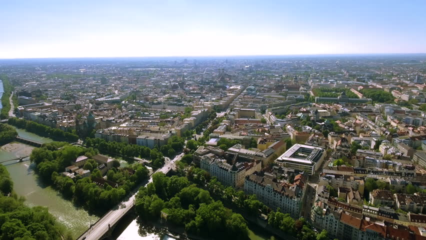 Aerial Video Flying By Over Munich City Center feat. Isar River around Beautiful Old Historical Town Buildings and Iconic Landmarks in Germany 4K UHD | Shutterstock HD Video #27850153