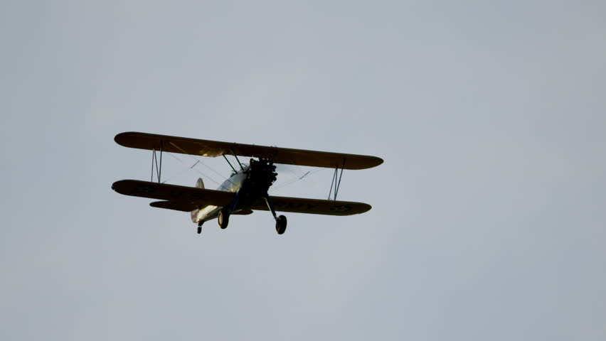 Biplane flying towards camera in super slow motion