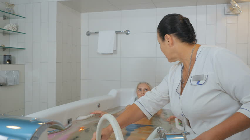 The doctor massages the pretty woman in hydrobath #27866923
