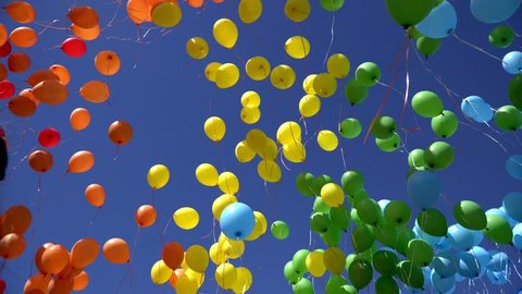 a lot of balloons in the sky