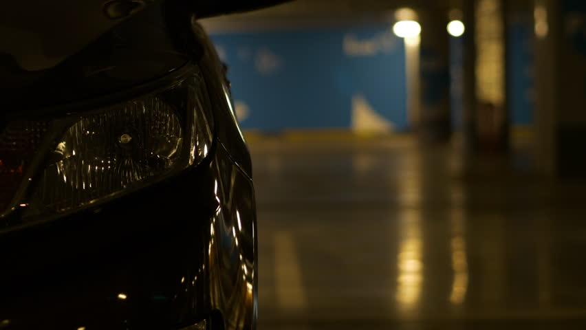 Woman Opens And Closes Door Of Car In Underground Garage