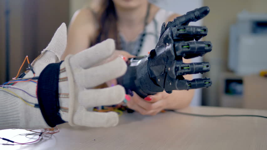 Bionic arm is making some movements. Artificial arm mechanism is being tested. 4K. | Shutterstock HD Video #27942553