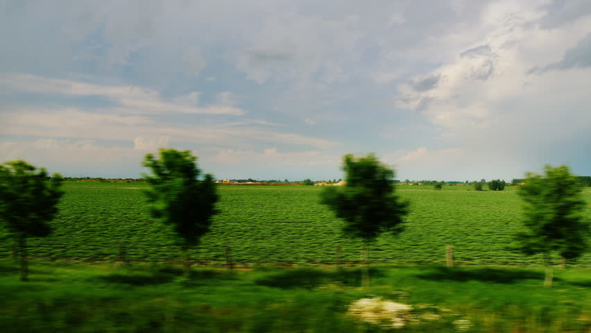 View from the car window - drive through the picturesque countryside and fields. 10 bit ProRes codec