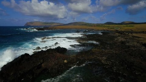 WS AERIAL Rocky coastline with waves / Tapati Rapa Nui, Easter Island, Chile