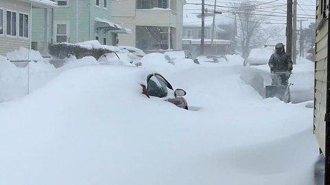 Snowstorm blizzard snowdrifts, snowblower clears street parked cars - Revere, Massachusetts USA - February 5, 2014