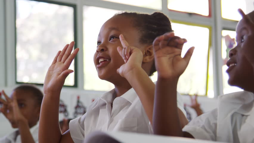 School kids counting with fingers at an elementary school | Shutterstock HD Video #28049509