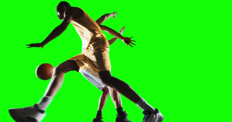 4K footage in slow motion basketball player dribbling in front of rival player on a green background ready to cut. All players wear unbranded basketball uniform.   Shutterstock HD Video #28050631