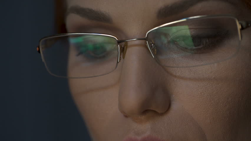 Laptop screen reflected in glasses, female working on laptop, concentration | Shutterstock HD Video #28054903