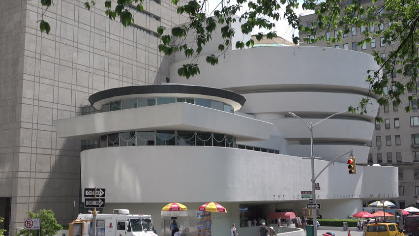 NEW YORK CITY, USA - MAY 19, 2017: Dolly shot moving alongside Guggenheim Museum. The Solomon R. Guggenheim Museum in New York City was the first Guggenheim Museum established.