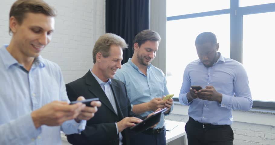 Mix Race Group Of Business People Texting Online Use Using Cell Smart Phones And Tablet Computers Messaging In Modern Office Slow Motion 60 | Shutterstock HD Video #28088911