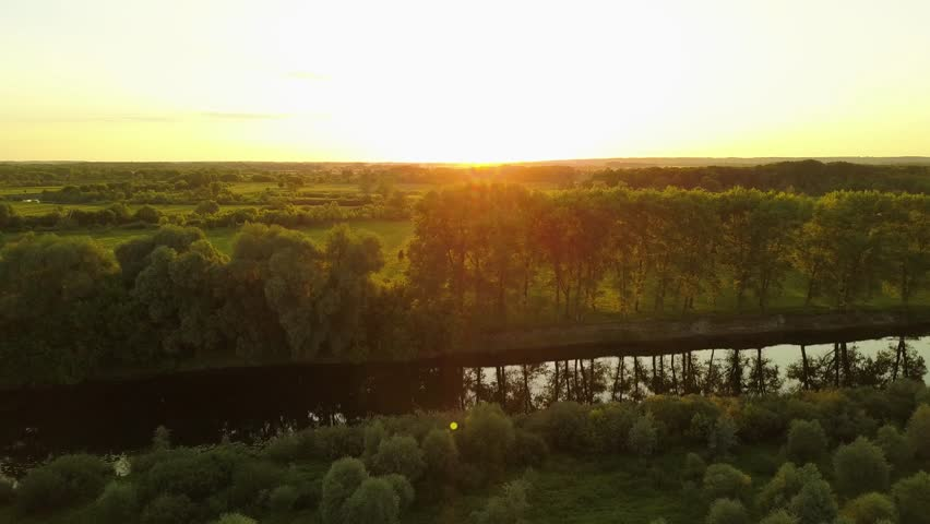 Flying over the trees and river at dawn - aerial videotaping | Shutterstock HD Video #28104283