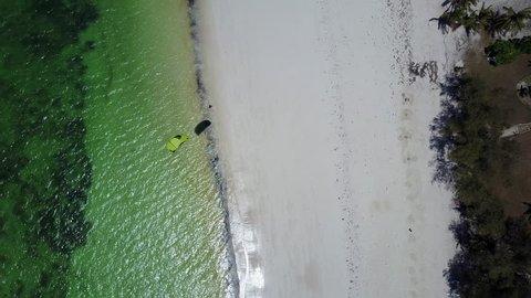 Diani Beach, Kenya Aerial flight over beach with kite surfer