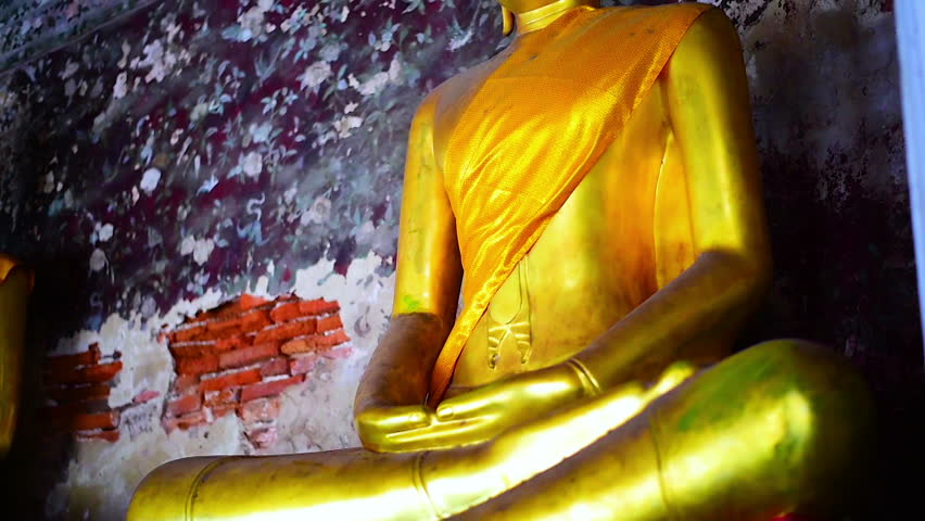 The golden Buddha statue at the temple in Thailand.   Shutterstock HD Video #28140763