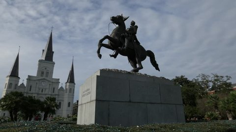Reverse tracking shot, left to right, of  the statue of Gen. Andrew Jackson statue at Jackson Square, French Quarter, New Orleans
