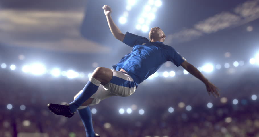 Soccer player succeed in making a strong kick while jumping horizontally. The players is wearing unbranded soccer uniform. Stadium and crowd are made in 3D.  Stadium and crowd are made in 3D.