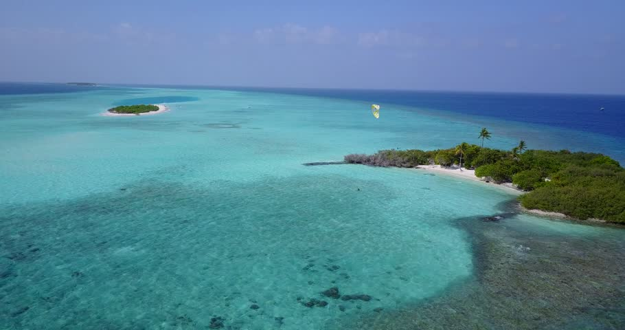 Aerial flying drone view of Maldives white sandy beach on sunny tropical paradise island with aqua blue sky sea water ocean 4k | Shutterstock HD Video #28212727