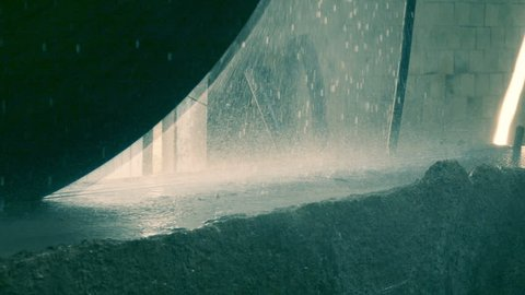 Close-up shot of a granite cutting by a circular saw, slow motion